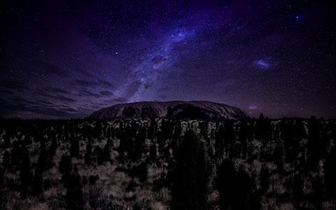 High-resolution desktop wallpaper Ayers Rock under Stars by Dominic Kamp