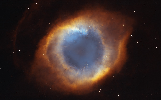 High-resolution desktop wallpaper The Helix Nebula's Iridescent Glory by NASA, NOAO, ESA, the Hubble Helix Nebula Team, M. Meixner (STScI), and T.A. Rector (NRAO)